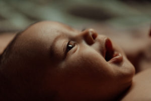 Close up of a baby smiling at home